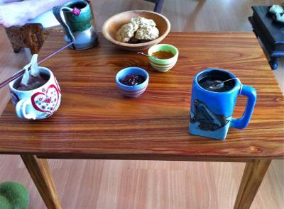 The finished coffee table in use - note the colored streaks in the canary wood