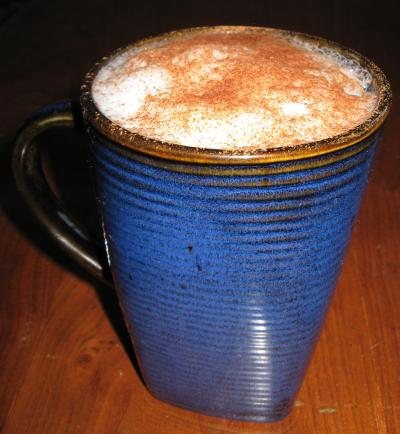 Chai Latte topped with ground cinnamon and cocoa powder