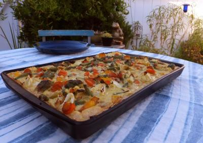 Vegetable Quiche on our outside table with the garden in the background