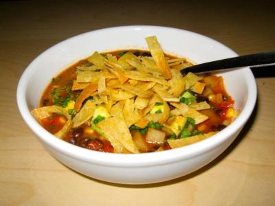 Vegan/Vegetarian Tortilla Soup in white bowl