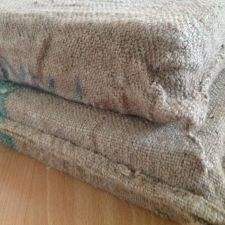 Corner view of two cushions clad in coffee bags - livingwiththewebers.com